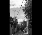 Wires and Woman in Laneway
